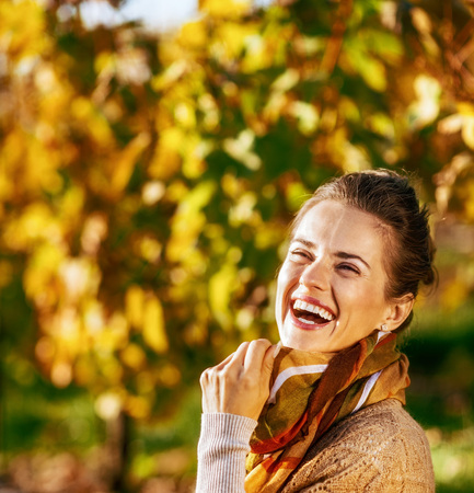 Photo for Portrait of smiling young woman in autumn outdoors - Royalty Free Image