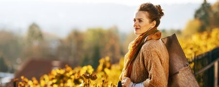 Photo for Young woman in autumn outdoors looking into distance - Royalty Free Image