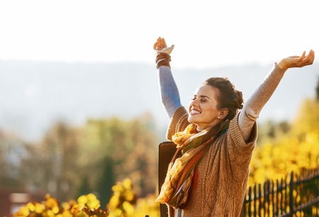 Photo for Happy young woman in autumn outdoors rejoicing - Royalty Free Image