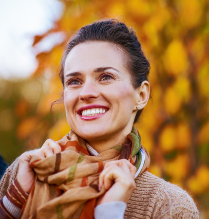 Photo for Portrait of happy young woman in autumn outdoors in evening - Royalty Free Image