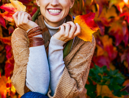Photo for Closeup on smiling young woman in front of autumn foliage - Royalty Free Image