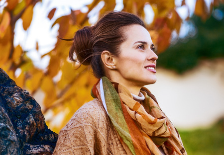 Photo for Portrait of young woman in autumn outdoors in evening - Royalty Free Image