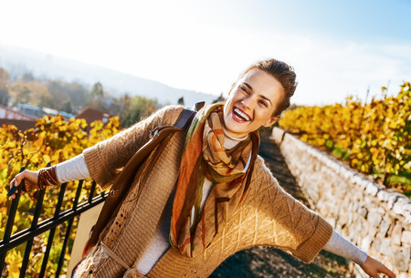 Photo for Portrait of happy young woman in autumn outdoors - Royalty Free Image