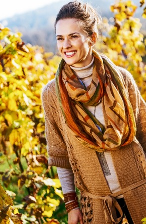 Photo for Happy young woman in autumn vineyard - Royalty Free Image