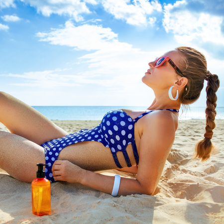 Photo for Sun kissed beauty. relaxed healthy woman in swimwear on the seacoast sun tanning - Royalty Free Image