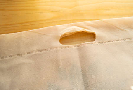 Foto de The concept of abandonment of plastic bags, ECO-bag of non-woven fabric, flat lay on a light wood background, top view, copy space. - Imagen libre de derechos
