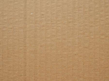 Foto de Brown corrugated cardboard useful as a background, soft pastel colour - Imagen libre de derechos