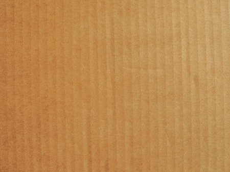Foto de Brown cardboard useful as a background, soft pastel colour - Imagen libre de derechos