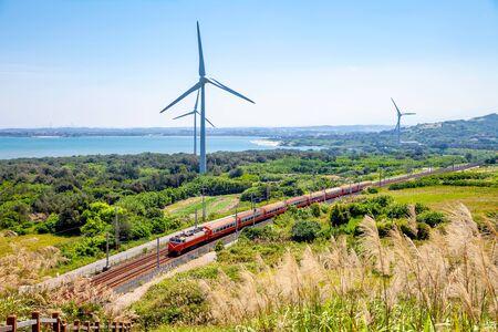 Foto de rainway at the coastline with wind turbine in Miaoli, Taiwan - Imagen libre de derechos