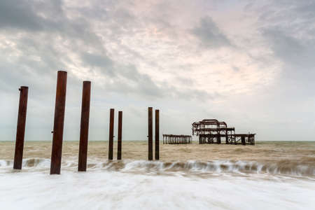 Photo for Atmospheric and Moody Long Exposure Photograph of the Ruins of the old Brighton West Pier at Brighton, East Sussex, England, UK. - Royalty Free Image