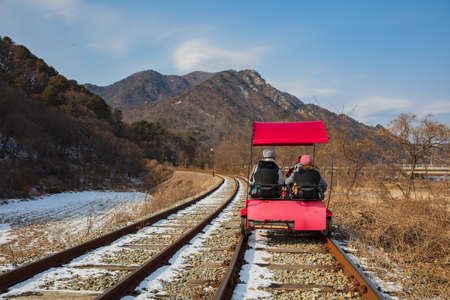 Photo pour Activity trolley tram running on railway track in winter - image libre de droit