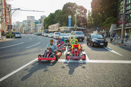 Photo pour Tokyo, JAPAN - October 16, 2016: Street kart tour, Mario kart tour is tourists dress up in superhero character costume - image libre de droit