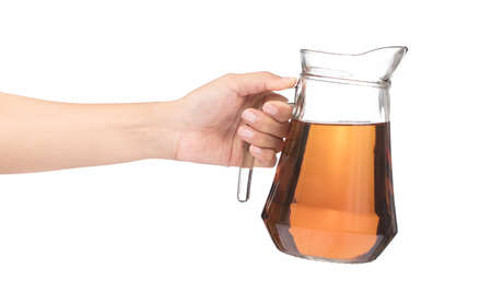 Photo for hand holding jug of tea isolated on a white background - Royalty Free Image