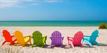 Photo for Adirondack Beach Chairs for a Summer Vacation in the Shell Sand on Captiva Sanibel Island Florida - Royalty Free Image