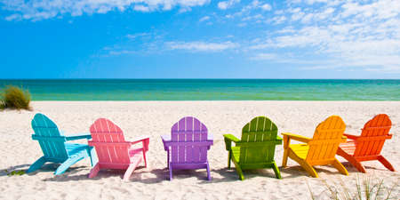 Photo pour Adirondack Beach Chairs on a Sun Beach in front of a Holiday Vacation Travel house - image libre de droit
