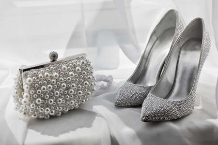 Photo pour glitter silver shoes and clutch bag on white - image libre de droit
