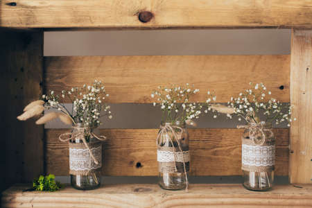 Photo for Gypsophila three jars standing on a wooden shelf - Royalty Free Image