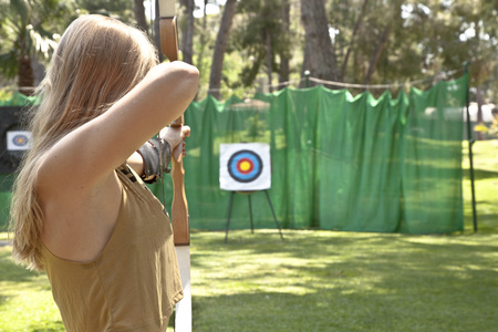 Photo for woman archery aiming for bullseye - Royalty Free Image