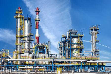 Photo for Petrochemical plant, oil refinery factory over blue sky. - Royalty Free Image
