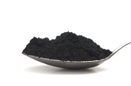 Photo pour Activated charcoal on white background - image libre de droit