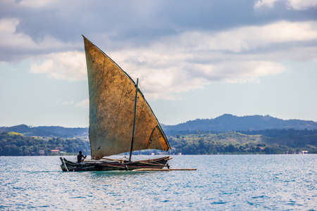 Foto de Traditional fishing pirogue with blue sky in Anakao, Madagascar - Imagen libre de derechos