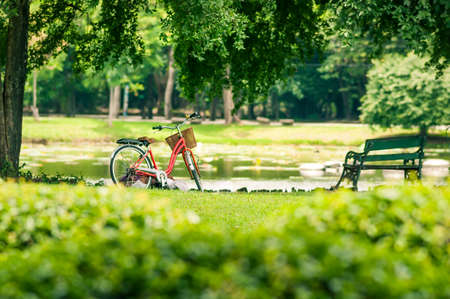 Photo pour Red bicycle in fresh summer park - image libre de droit