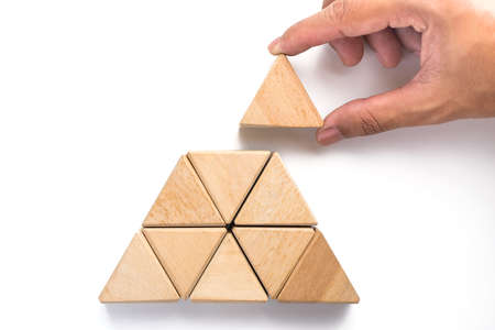 Photo pour Triangles wood block arranging as stack step can use for business template or bullet or infographic. Wood block on white background. - image libre de droit