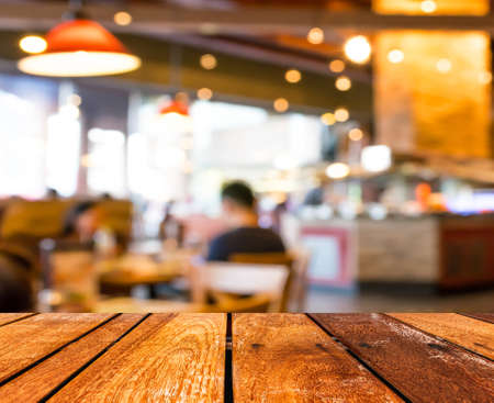 Photo for Empty wood table and Coffee shop blur background with bokeh image. - Royalty Free Image