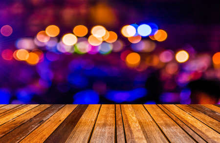 Photo for image of wood table and blurred bokeh background with colorful lights (blurred) - Royalty Free Image