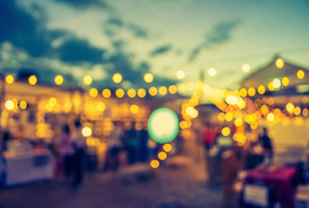 Foto de vintage tone blur image of night festival on street blurred background with bokeh . - Imagen libre de derechos
