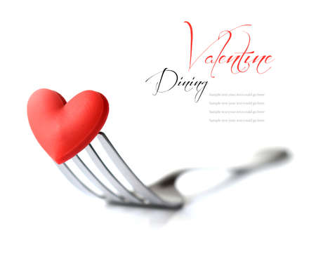 Macro studio image of stainless steel fork with red heart  Concept image for Valentine dinner love food love cooking etc