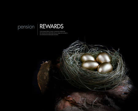 Photo for Creatively lit concept image for pension investments and financial planning. Gold eggs nestled in a real birds nest resting on dark wood against a dark background. Copy space. - Royalty Free Image