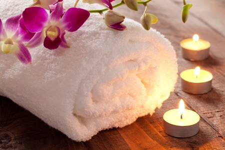 spa concept with candle and towel