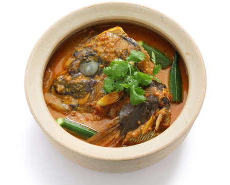 Photo for fish head curry, singaporean cuisine, on white background - Royalty Free Image