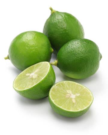 Foto de fresh key limes on white  - Imagen libre de derechos