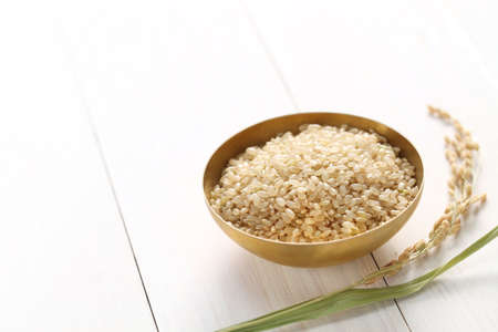 Foto per brown rice with ear of rice, japanese healthy food, copy space - Immagine Royalty Free