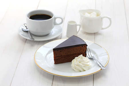 Foto de homemade sachertorte Austrian chocolate cake and coffee - Imagen libre de derechos