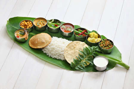 Foto per meals served on banana leaf, traditional south indian cuisine - Immagine Royalty Free