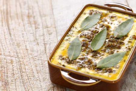 Foto de bobotie is a curry flavored meatloaf with baked egg on top. - Imagen libre de derechos