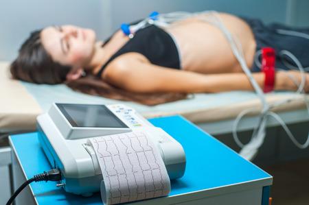 Foto de Electrocardiogram, cardiac cardiograph and conduct research,  ECG and examination of the heart during pregnancy - Imagen libre de derechos