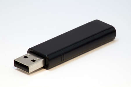 A black usb storage device isolated on white.
