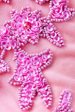 Photo for Fabric with sequins and sequins of bright colors. Fashion glitter fabric, sequins. can be used as background - Royalty Free Image