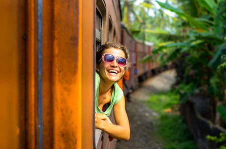 Photo pour Young woman traveling by train in Sri Lanka - image libre de droit