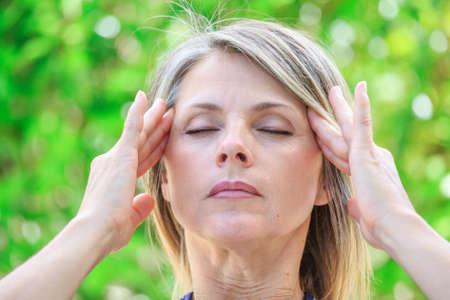 Foto de woman with intense stress and painful headache - Imagen libre de derechos