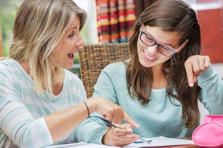 Foto de pretty student girl taking tutoring courses with beautiful blond teacher - Imagen libre de derechos