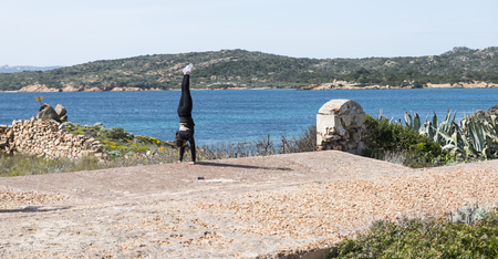 Photo for boy doing handstand on the road - Royalty Free Image