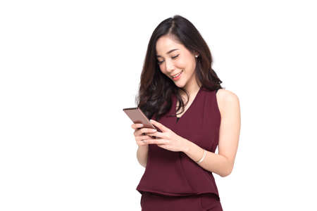 Photo pour Woman use of cellphone isolated on white background, Businesswoman is typing SMS on mobile phone, Close up portrait of a happy lady playing games on smartphone, Asian Thai model - image libre de droit