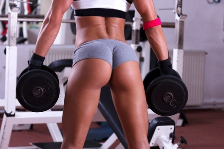 Foto de Very sexy young beautiful ass in thong at the gym club - Imagen libre de derechos