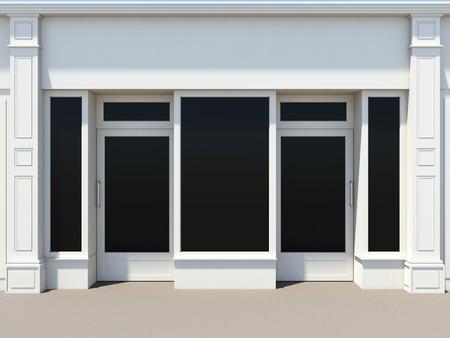 Foto de Shopfront with two doors and large windows. White store facade. - Imagen libre de derechos