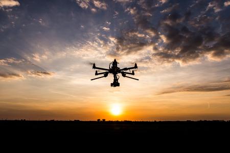 Foto de Professional drone flying in the sunset - Imagen libre de derechos